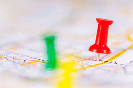 Colorful push pins on a map