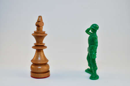 Chess king face off with Army Men toy