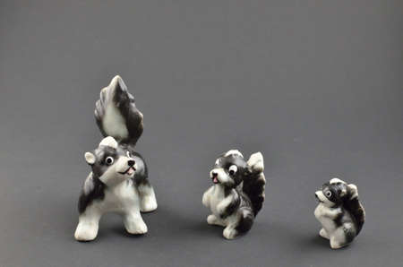 Skunk family antique figurines
