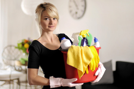 microfiber: Beautiful woman with bucket of cleaning supplies Stock Photo