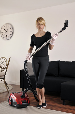keeping room: House cleaning, woman vacuuming  in house