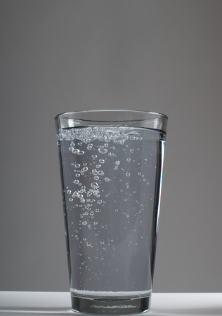 Glass of water on a white background Stok Fotoğraf