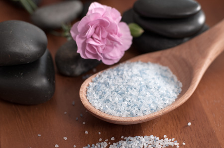 Spa and wellness setting with sea salt and stones for massage.  Stok Fotoğraf