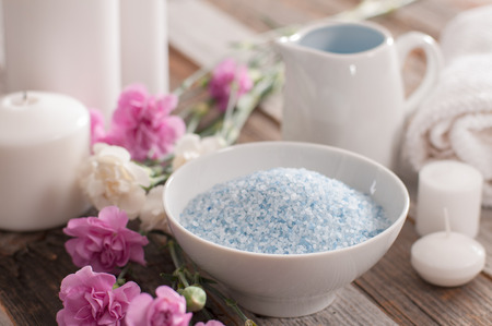 Spa and wellness setting with sea salt, candles and towel. Dayspa nature products  Stok Fotoğraf