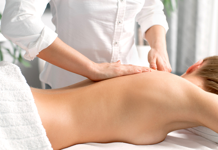 Beauty treatment concept. Beautiful woman having massage at spa salon
