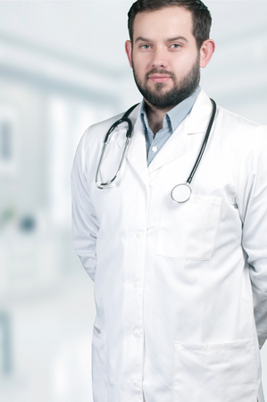 doctoring: Medical doctor with stethoscope around his neck