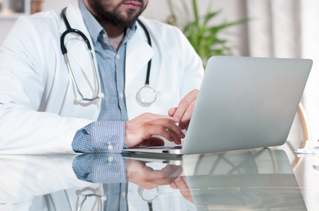 doctoring: Doctor working on desk with laptop computer in doctors office. Medical, doctor concept Stock Photo