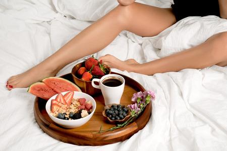 Morning and Healthy breakfast.  Woman having breakfast in bed.