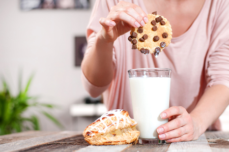 Glass of milk and chocolate chip cookies, tasty healthy breakfast Stock Photo