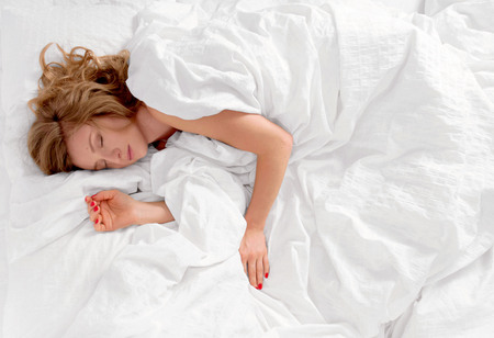 Beautiful woman sleeping in the bed