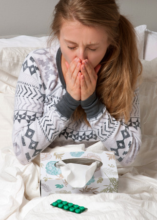 sniffles: Sick and Virus. Woman has cold, flu and high fever.