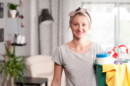 Cleaning woman with bucket of cleaning supplies