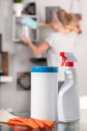 Cleaning supplies. Professional cleaner doing cleanup in ordinary apartment Imagens