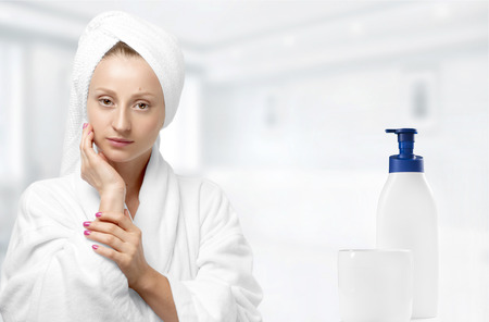 Beauty and skin care. Beautiful woman with perfect skin wrapped with towels after spa therapy