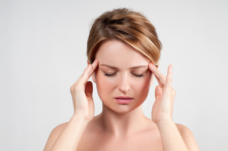 Woman suffers from terrible headaches and compresses the head with fingers Stock fotó - 80149293