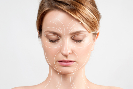 Face of woman with perfectly clean skin and massage facial lines. Skin Care. Face lift anti-aging treatment Stock Photo