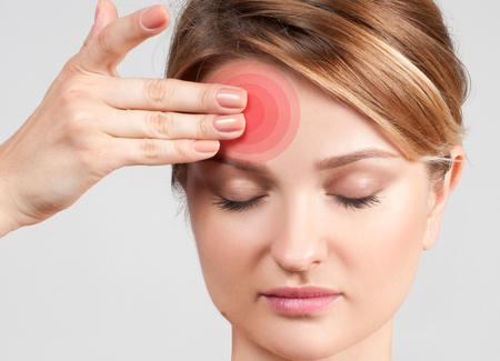 headaches: Woman having headache migraine