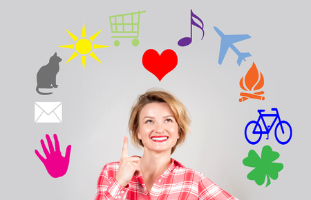 Beautiful happy woman with multimedia icons around her head Stock Photo