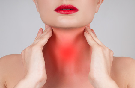 Pain throat concept. Young woman has sore throat touching the neck Zdjęcie Seryjne - 80560233