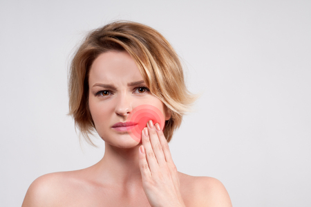 Tooth pain and dentistry, woman feeling strong toothache.