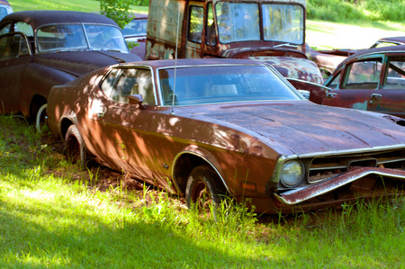 Rusty old cars in abandoned place, junkyard - vintage style