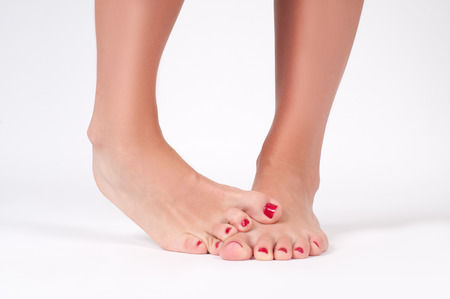 Foot fungus. Beauty and foot care. Female feet on white background.