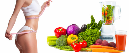Successful weight loss, slim and sporty woman, diet concept with fresh vegetables and fruit