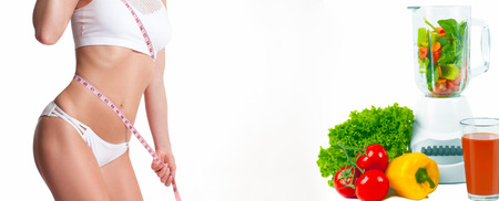 Diet concept, fresh vegetables and fruits. Woman measuring her body with a measure tape