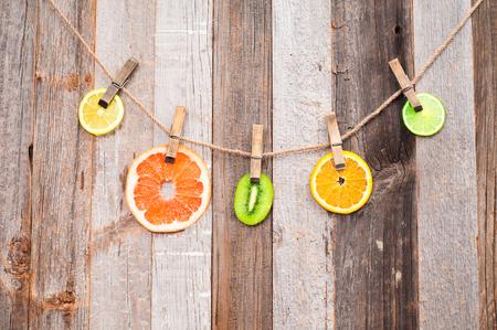 Fresh Citrus Fruits. Pieces Fruits on wood background. Stock Photo