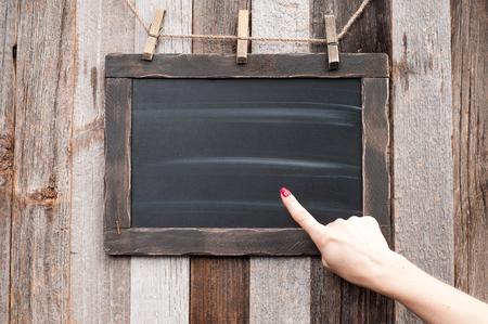 Hand showing on Chalkboard. Human hand pointing on blackboard. Stock fotó