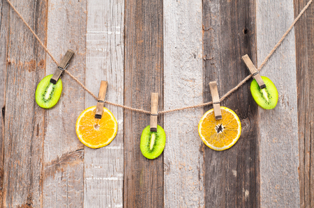 clench: Fresh Citrus Fruits. Pieces Fruits on wood background. Stock Photo