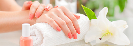Manicure concept. Hand care at the spa. Beautiful womans hands with perfect manicure at  beauty salon. Stock Photo