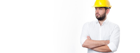 warehouse building: Contractor in yellow helmet on white background. Architect in builder helmet. Stock Photo