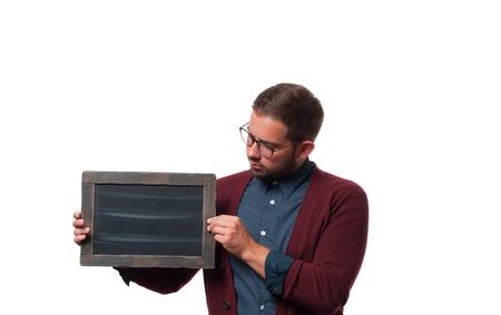 Business man holding empty black board