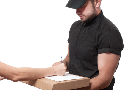 Delivery man holding a parcel while woman putting signature in clipboar.  Courier service concept