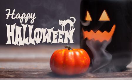 Happy Halloween. Spooky pumpkin with smoke in the dark night Stock Photo