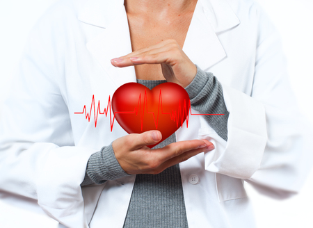 doctoring: Female Doctor is showing heart shape. Medical Insurance Concept Stock Photo