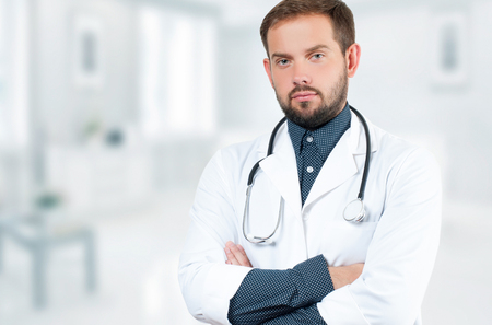 doctoring: Male Doctor with stethoscope in hospital. Healthcare, Medical Concept