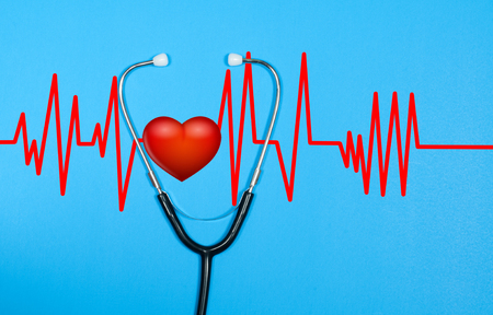 Medical stethoscope and red heart with cardiogram on blue background. Health Concepts Zdjęcie Seryjne