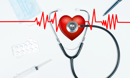 Stethoscope and red heart. Workplace of doctor with medical items and pills Stock Photo