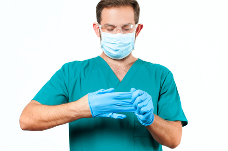 doctoring: Male Doctor with protective mask and gloves.  Medical  Concept
