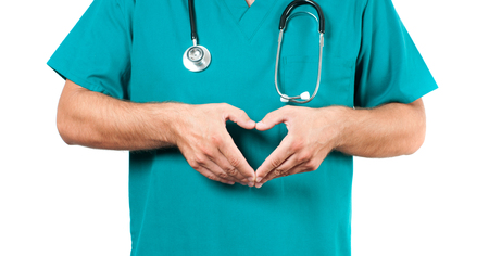 doctoring: Male doctor with stethoscope is making heart shape.  Medical Insurance Concept