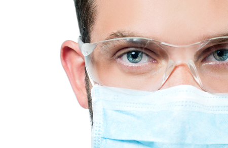 Portrait of doctor with protective glasses and mask. Face and eyes
