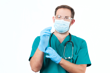 Male Doctor with stethoscope and protective mask and gloves.  Medical  Concept Stock Photo