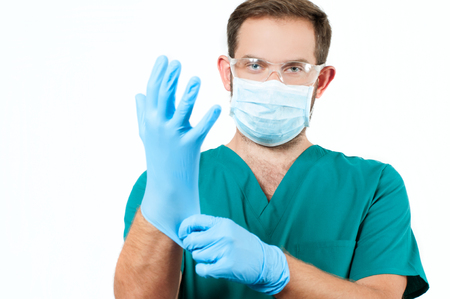 doctoring: Male Doctor with stethoscope and protective mask and gloves.  Medical  Concept Stock Photo