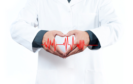 Male Doctor is making heart shape. Medical Insurance Concept 版權商用圖片