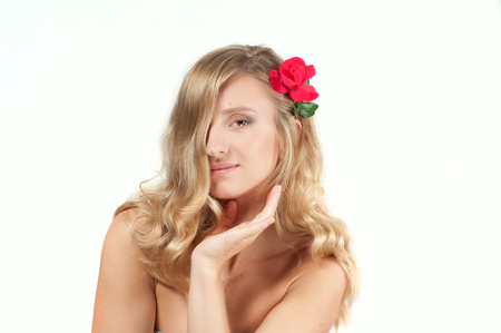 Portrait of blond woman with long healthy hair. Beauty and spa, girl with perfect fresh clean skin. Stock Photo