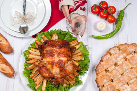 Thanksgiving or Christmas. Homemade  roasted whole turkey on wooden table. Thanksgiving Celebration Traditional Dinner Setting Food Concept