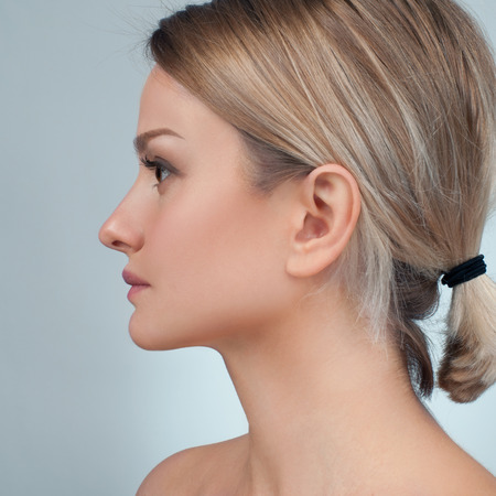 Portrait of female profile face. Plastic surgery. Anti-aging treatment and face lift.
