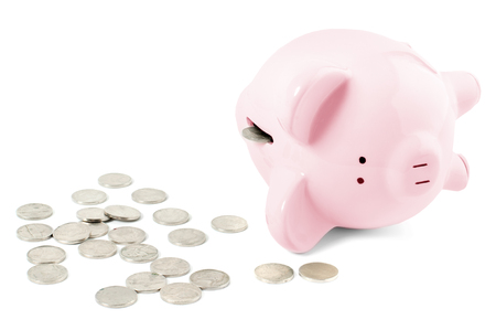 Empty pink piggy bank and coins on white background